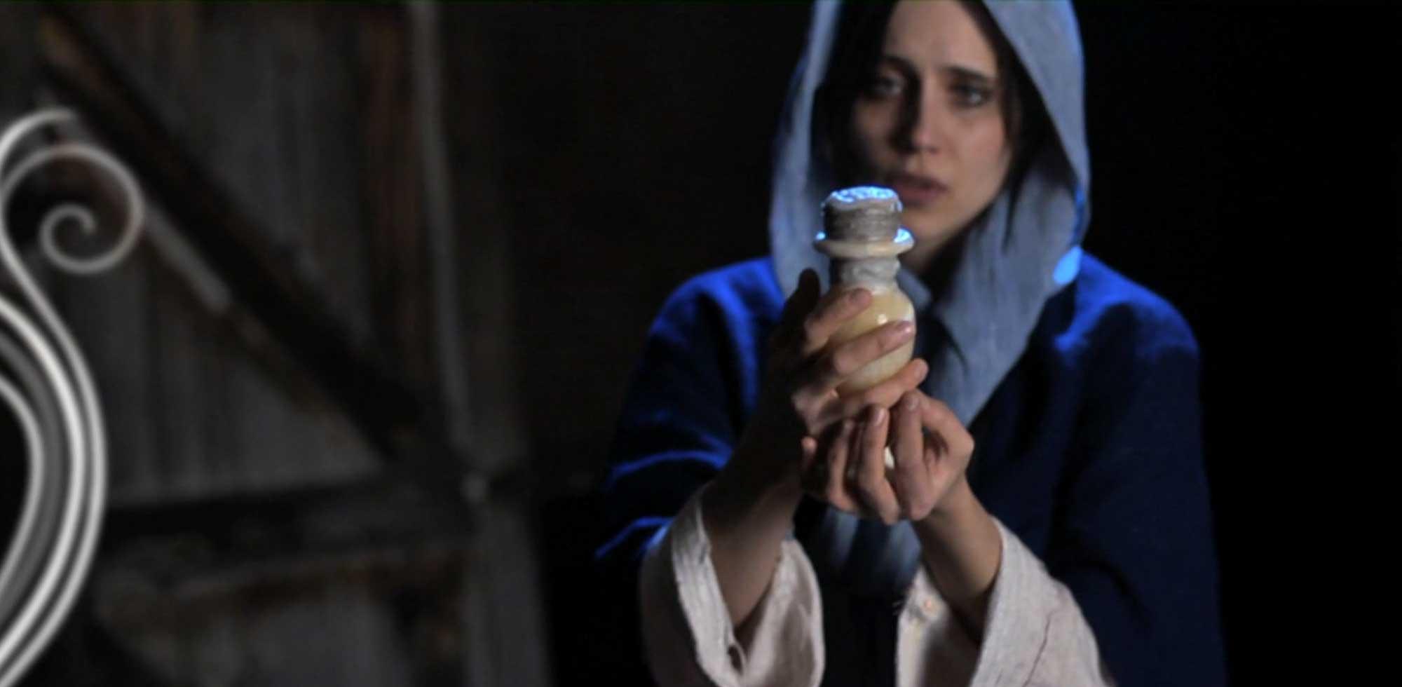 Mary holding a jar of perfume