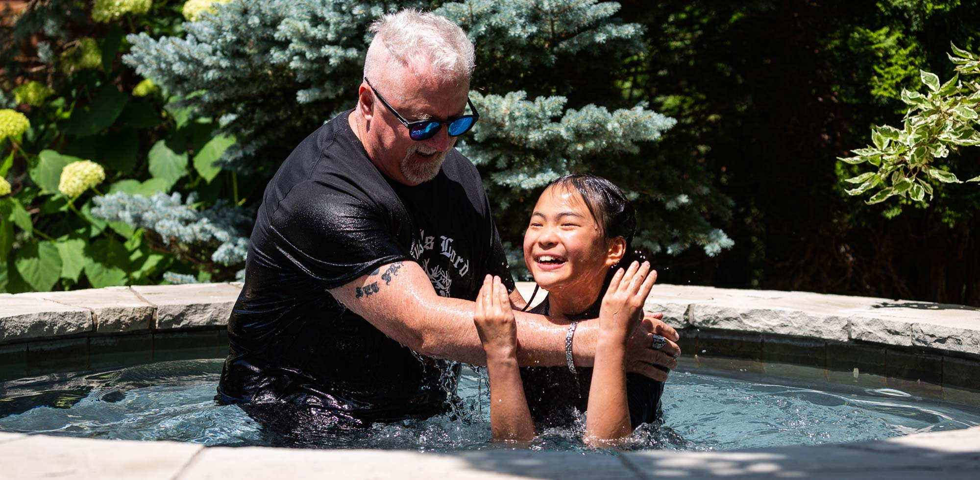 Kristen Pui being baptized by Jack Aldred